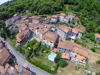 AERIAL VIEW OF VILLAGE OF SAN CASSIANO DI COCOLIO, VILLA IN CENTRE