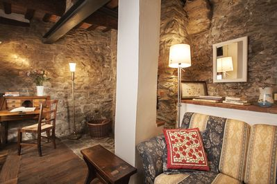 Ground floor sitting room with writing desk, couch, artisan well & adjacent bath