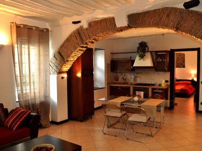 Photo for Casa Lisa apartment with private garden and free parking space