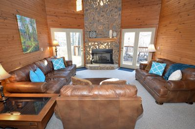 The great room with comfy leather seating, gas fire, and amazing view!