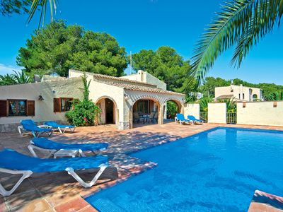 Photo for This 4-bedroom villa for up to 8 guests is located in Javea and has a private swimming pool and Wi-F