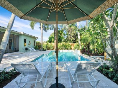 Photo for Turquoise Retreat - heated salt water pool and tropical landscape