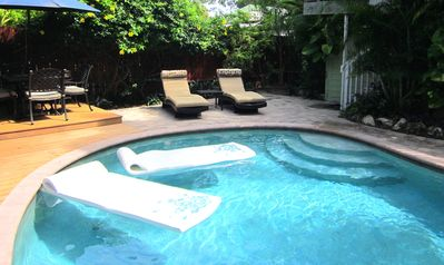 Private, heated pool. Deluxe portofino loungers. Cafe table.