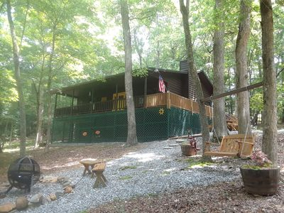plenty of outdoor space with hot tub, fire pit, swing and picnic table