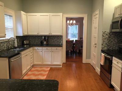 Kitchen features granite countertops and stainless appliances