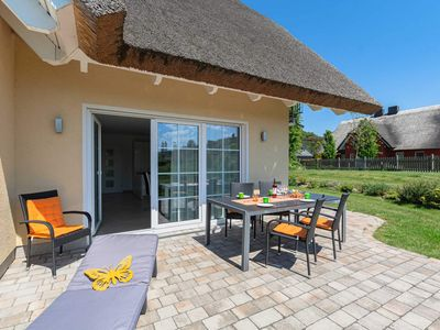"""Photo for House half B - thatched roof beach villa """"Babette"""", directly on the sea, with sauna .."""