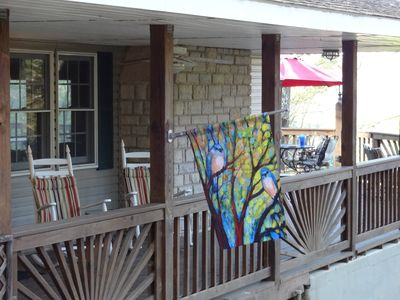 sit and rock on the covered deck or eat at 1 of 2 tables on the open deck