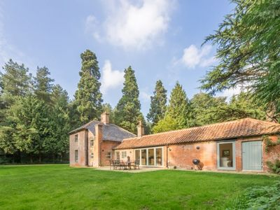 Photo for Bear's Cottage is a secluded delightful four bedroom holiday retreat in Wood Norton near Holt.
