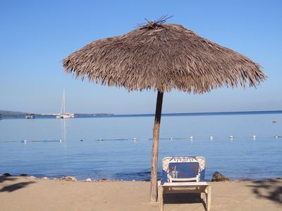 Photo for Secluded sea-view apartment 2 mins from beach, WiFi, 24hr security