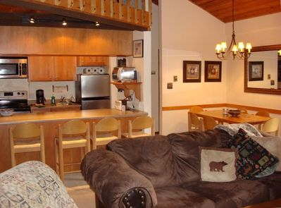 View of Living Room, Kitchen, Breakfast bar and Dining Area.
