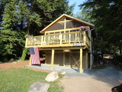 "Photo for Large open deck overlooking the lake at this ""Lake View Cottage"" in Lake Mokoma"
