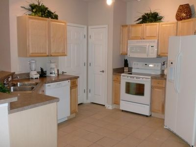 Panoramic view of fully equipped kitchen.