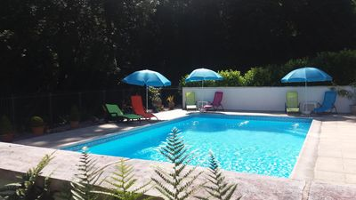 Photo for Beautiful 15th century character gite with shared pool set in stunning woodland
