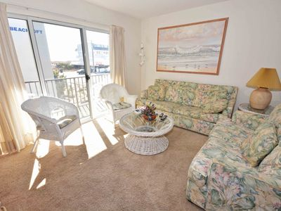Photo for Comfortable, spacious 2-bedroom condo with free WiFi and adorable spring decor located midtown and just a block from the beach!
