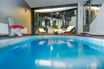 Pool overlooking patio and Athenian style room.