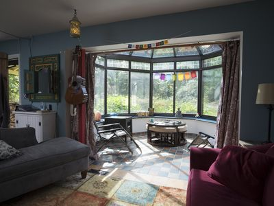 Photo for 1 mile to Woodstock Village! Sunny, Artsy, Private Deck, Firepit, Sleeps 8!
