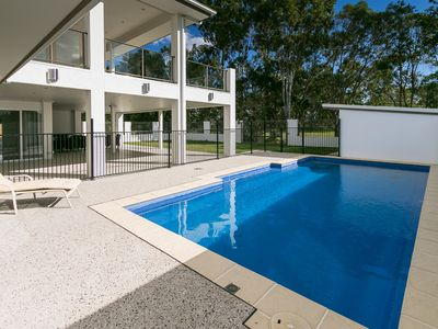 Photo for Huge, Modern, Waterfront home with Air con & pool!
