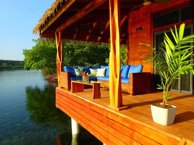 Over-the-water covered deck with lounge seating area with coffee table