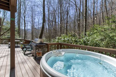Hot tub and gas grill on back deck