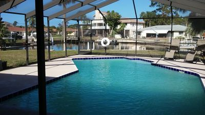 pool with canal view in backyard