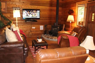 Big screen with DirecTV and fireplace stove