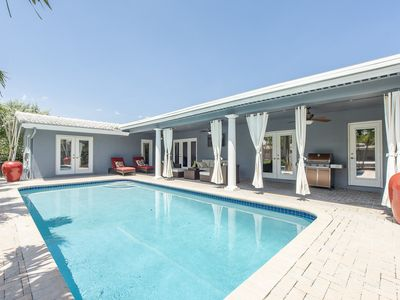 Photo for Water front villa, salt water heated pool, very central