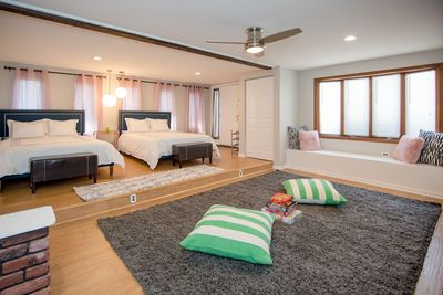 Family suite with 2 queen size beds / cozy shag rug and board games