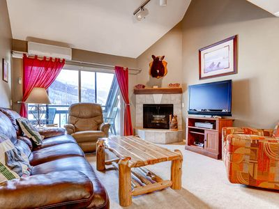 Photo for AIR CONDITIONED AND steps from the Mountain Festivities.  Watch from your private balcony.  Beautiful condo, log furniture, private balcony facing the mountain, clean and comfortable.    Great location for watching the fireworks and mountain activities.  FREE PARKING, FREE WI-FI