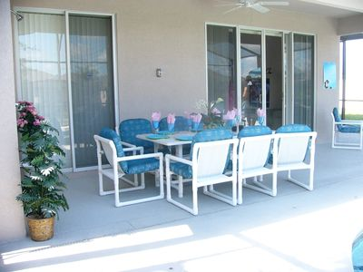 Terrace Dining with ceiling fan under lanai.