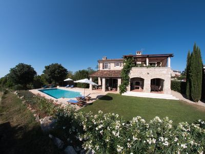 Villa Olivia with a large 10m x 5m heated pool and landscaped garden.