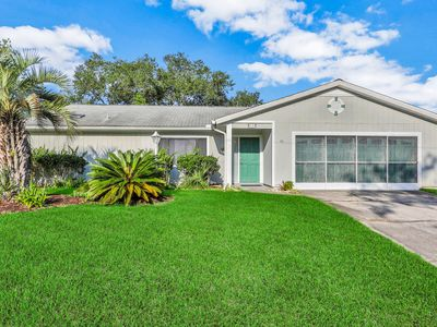 Photo for NEW LISTING! Canal-front home with private dock & screened-in sunroom