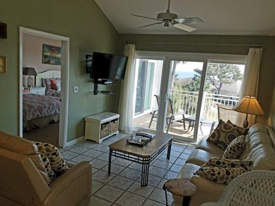 Spacious living area with access to ocean view patio