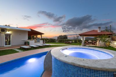 The pool, jacuzzi and terrace are wonderfully lit at night!