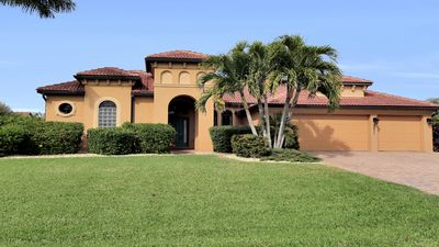 Photo for Stunning SW Cape Coral Waterfront Home - Heated Pool, Spa & Entertainment Room!