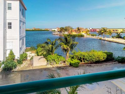 Photo for Lagoon-front condo with views & shared pool - walk to beaches and restaurants!