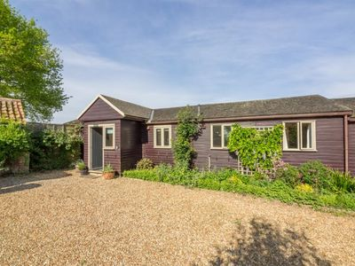 Photo for This charming wooden cottage is just 15 minutes from the coast.