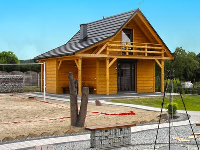 Photo for A wooden, eco-friendly house by the Goszcza lake. Living room, 2 bedrooms.