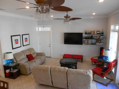 Bright Living room with abundant seating invites family activities