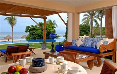 View from kitchen out to the patio, pool and ocean.