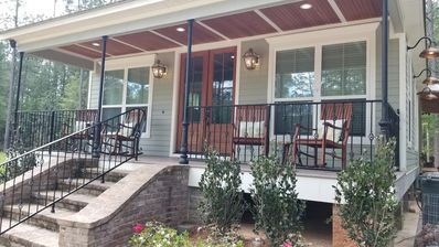 Front porch with New Orleans Wrought Iron. 4 confy porch rocking chairs!