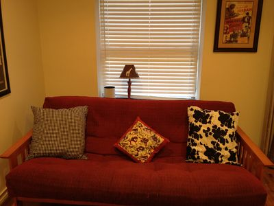 futon opens to Queen size bed in living room