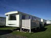 Nice caravan, close to the entertainment area and shop. Not completely faultless but decent.