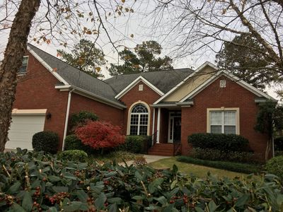 Photo for Masters ready 5 bed 3 full bath open layout & landscaped for privacy
