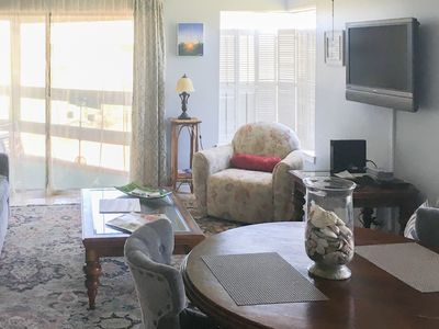Photo for Charming Ground-Level Condo with Beach Views from Covered Patio