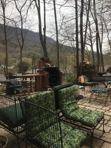 Outside patio with fireplace and Lookout Mt in background