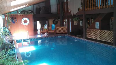 Pool room--let's swim! Stairs lead up to isolated second bedroom