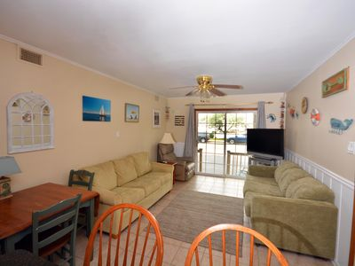 Photo for Laid-back 3 bedroom condo with outdoor pool and free WiFi located on the bayside close to a mini park!