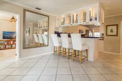 Fully equipped kitchen with bar seating for 3