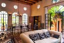 Sunny, expansive living room and dining area that opens up to courtyard.