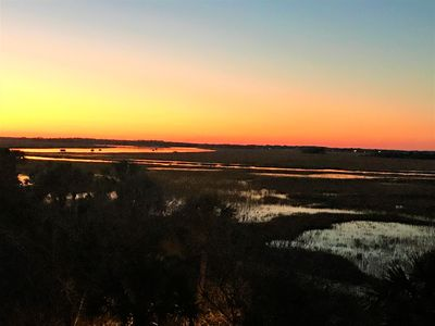 Magnificent sunsets over the marsh and Folly River